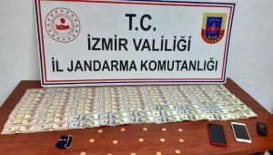 İzmir'de kendilerini polis olarak tanıtan dolandırıcılar vatandaşı tuzağına düşürdü
